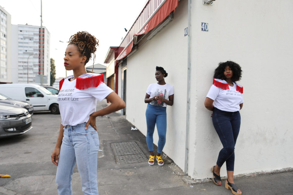 "Designer Aisse N'diaye (R) and friends Sandrine Alcan (L) and Virginie Ehonian (C) wear T-shirts from N'diaye's brand Afrikanista in Clichy-sous-bois, France, August 26, 2016. N'diaye grew up in Clichy-sous-bois, where her parents currently live. REUTERS/Joe Penney SEARCH ""CREATIVE BANLIEUE"" FOR THIS STORY. SEARCH ""WIDER IMAGE"" FOR ALL STORIES. THE IMAGES SHOULD ONLY BE USED TOGETHER WITH THE STORY - NO STAND-ALONE USES."