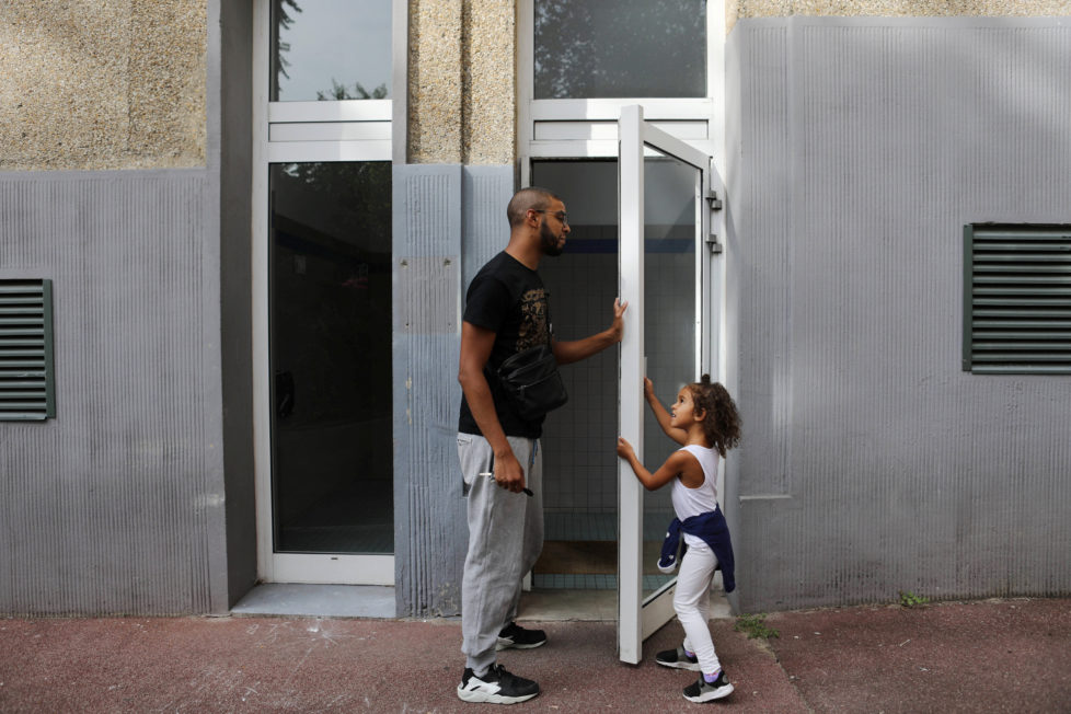 "Rapper Worms-T walks with his daughter to his apartment building in Pantin, France, September 2, 2016. REUTERS/Joe Penney SEARCH ""CREATIVE BANLIEUE"" FOR THIS STORY. SEARCH ""WIDER IMAGE"" FOR ALL STORIES. THE IMAGES SHOULD ONLY BE USED TOGETHER WITH THE STORY - NO STAND-ALONE USES."