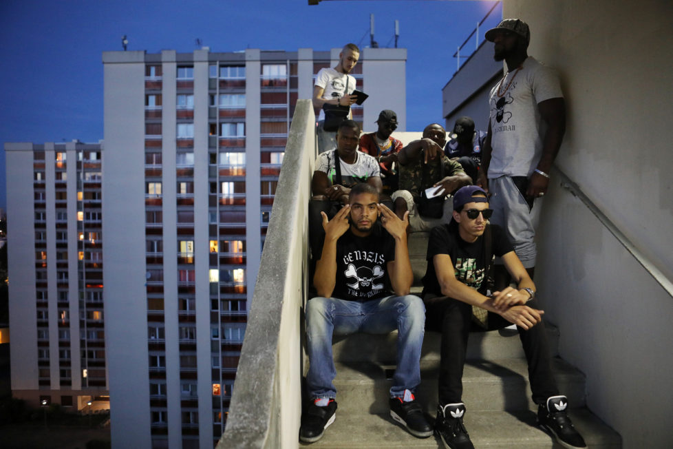 "Rapper Worms-T poses for a picture with friends from the ""La Rue La Vraie"" (The Real Street) crew on a staircase in the Cite Raymond Queneau in Pantin, France, September 1, 2016. REUTERS/Joe Penney SEARCH ""CREATIVE BANLIEUE"" FOR THIS STORY. SEARCH ""WIDER IMAGE"" FOR ALL STORIES. TPX IMAGES OF THE DAY?THE IMAGES SHOULD ONLY BE USED TOGETHER WITH THE STORY - NO STAND-ALONE USES."