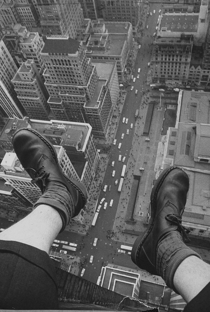 A shot of photograher Grey Villet attempting to cure the fear of heights by getting out on the 58th floor window ledge and photographing his feet hanging over 5th Ave and 42nd street. (Photo by Grey Villet//Time Life Pictures/Getty Images)