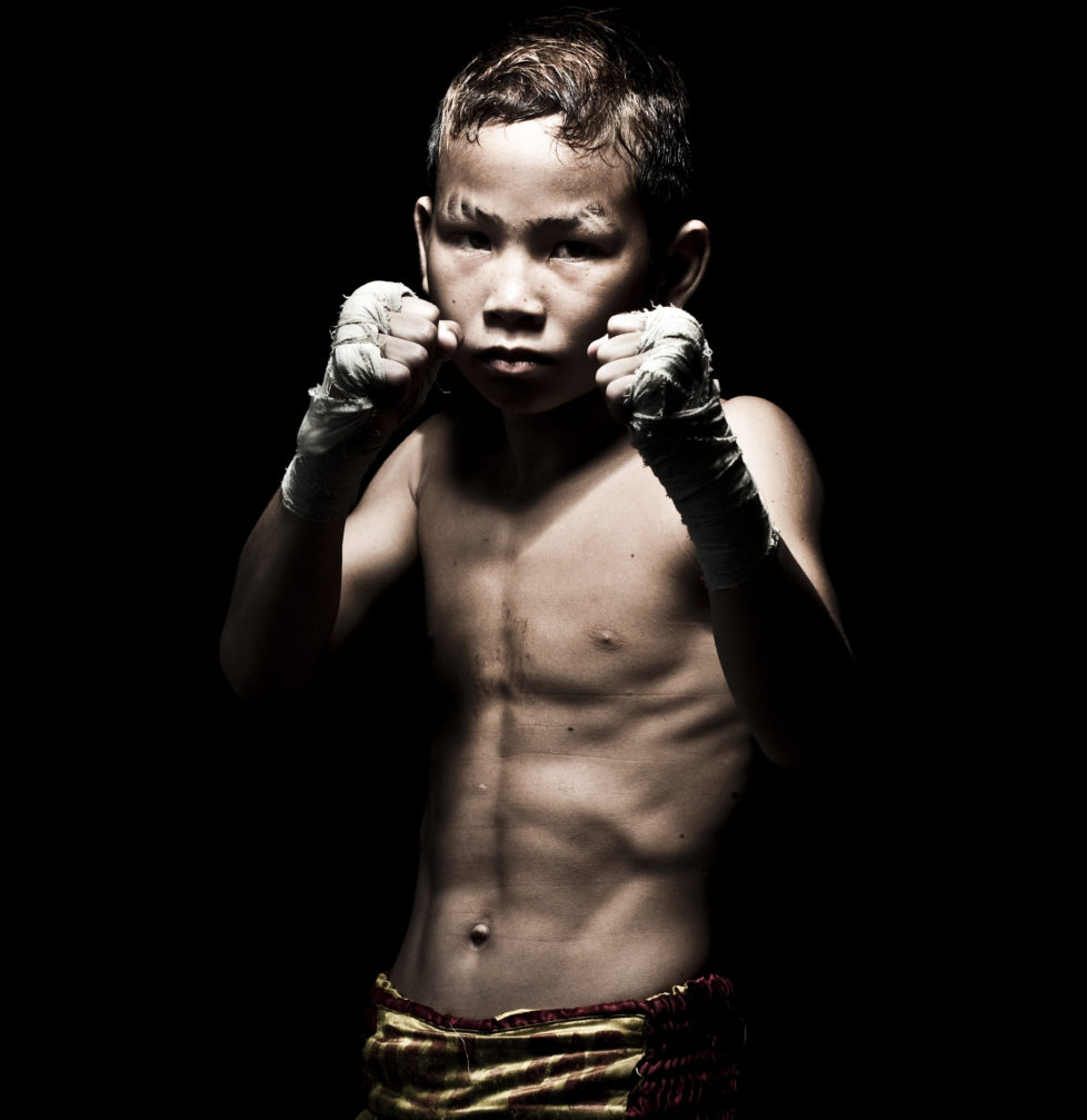 "Muay Thai Kickboxing fighter Suwanaked poses at Sangmorakot gymnasium in Bangkok, Thailand. Muay Thai, also know as ""Art of Eight Limbs"", is a combat martial art and Thailand's national sport. (Photo by Victor Fraile/Corbis via Getty Images)"