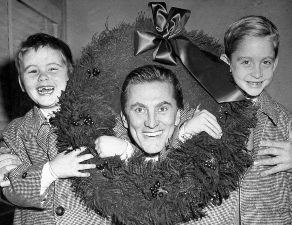 UNITED STATES - DECEMBER 15: Kirk Douglas with sons, Joel and Michael, at Idlewild Airport. (Photo by Art Edger/NY Daily News Archive via Getty Images)
